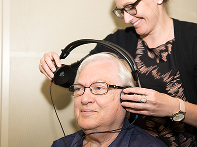 Image of JRMC Audiologist, Marissa M. Leese, performing a hearing test on a patient.