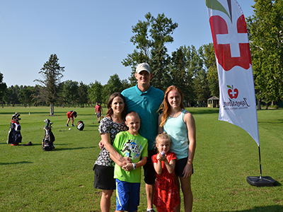 "Image of Dr. Mandy and Dave Sorlie Family, founders of the ANGELS Fund at GOLF ""fore"" ANGELS tournament."