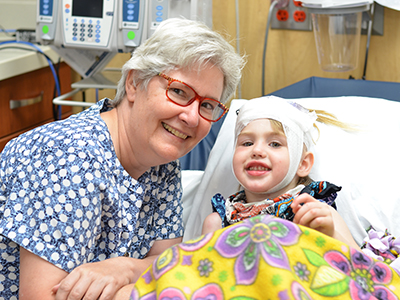 JRMC pediatric patient, Arianna Walch, receives 8-hour infusion for rare Batten's Disease and received new playground after first treatment.