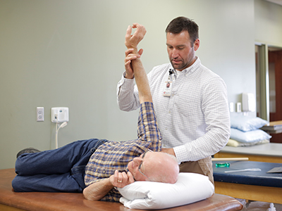 Image of Cody Champagne, a JRMC Rehabilitation Department physical therapist.