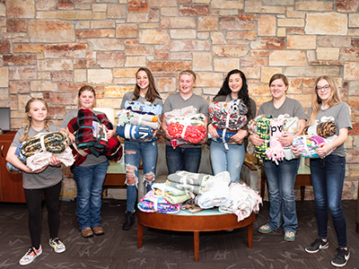 Higher Power Youth League students from the Gackle Emanuel Lutheran Church donated tie blankets and a $250 gift card to the Kala's Korner program at JRMC.